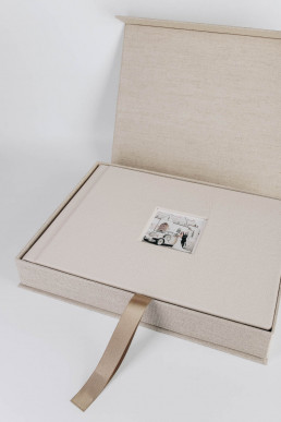 wedding book with small photo of the couple and beige genuine leather